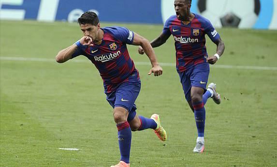 Hai bàn vào lưới Celta Vigo giúp Suarez có 13 pha lập công ở La Liga mùa này, xếp thứ ba trong danh sách dội bom. Ảnh: AP.