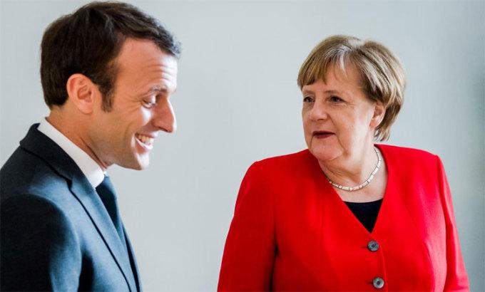 Tổng thống Pháp, Macron và Thủ tướng Đức, Merkel có quyền vui mừng về thành tích của bóng đá quốc gia. Ảnh: Reuters.