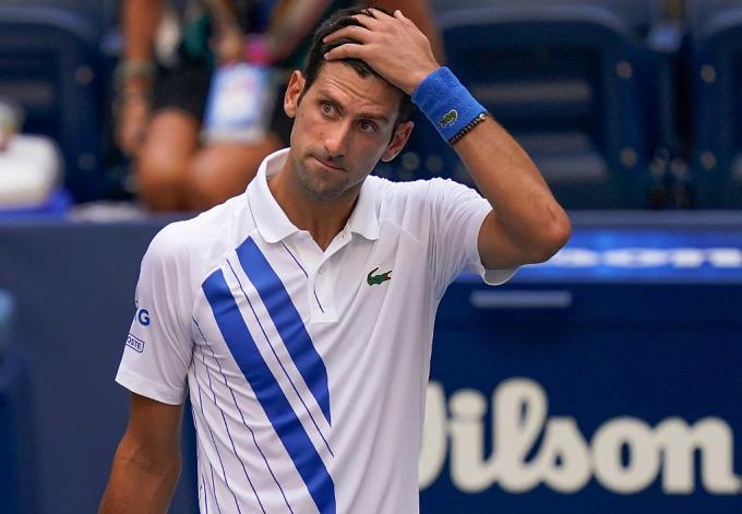 Djokovic đứt mạch 29 trận thắng liên tiếp khi bị xử thua tại Mỹ Mở rộng. Ảnh: AP.