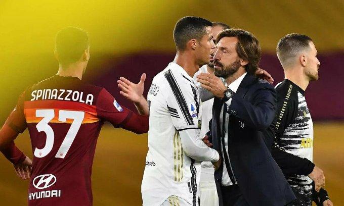 Pirlo (mặc vest) ôm Ronaldo khi hết trận gặp Roma. Ảnh: AFP
