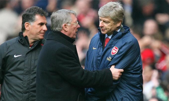 Ferguson và Wenger là địch thủ của nhau thời còn làm việc tại Ngoại hạng Anh. Ảnh: Reuters.