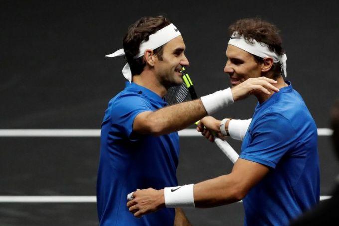 Nadal và Federer cùng chia sẻ vị thế tay vợt sở hữu nhiều Grand Slam nhất lịch sử. Ảnh: The Straits Times.