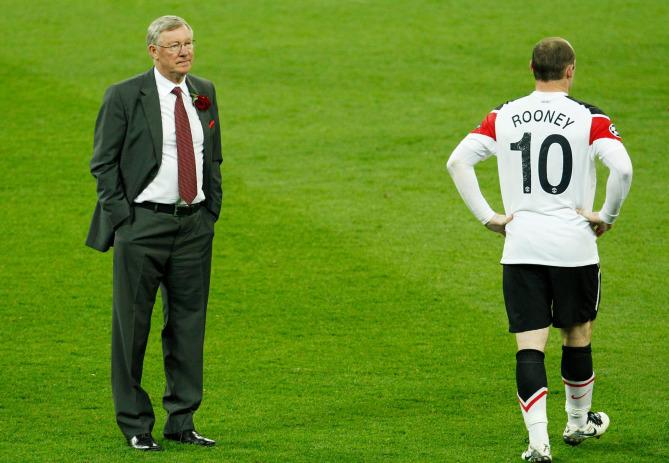 Ferguson (trái) hai lần thua Barca của Pep Guardiola ở chung kết Champions League 2009 và 2011. Ảnh: Reuters