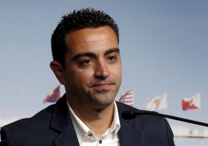 Xavi từng chơi 17 năm cho Barca, trong đó có nhiều năm dẫn dắt hàng tiền vệ và đeo băng đội trưởng. Ảnh: Reuters.