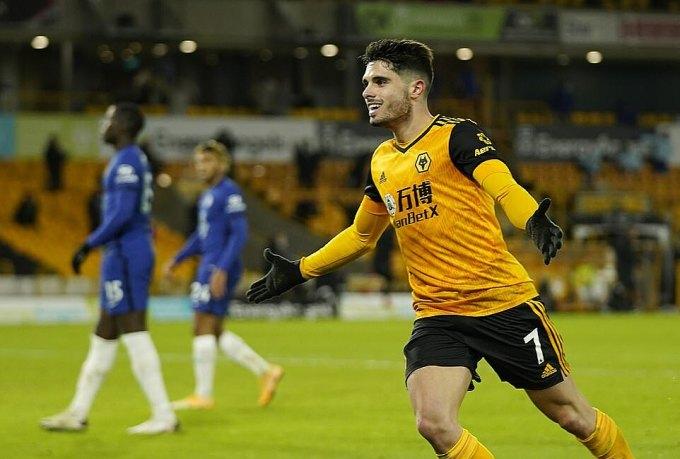 Pedro Neto ghi bàn ấn định chiến thắng cho Wolves ở phút bù giờ thứ 5. Ảnh: Reuters.