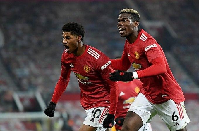 Pogba (phải) mừng bàn thắng với Rashford. Ảnh: Reuters.