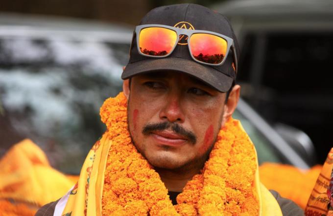 Nirma Purja xem việc nhóm leo núi 10 người của anh chinh phục thành công K2 vào mùa đông là một niềm tự hào của Nepal. Ảnh: NatGeo