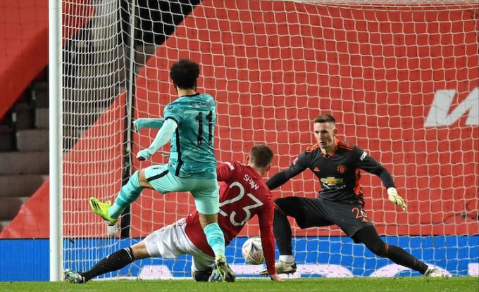 Salah ghi cú đúp nhưng không thể giúp Liverpool thoát thua. Ảnh: FA.