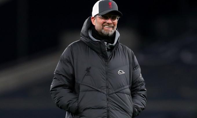 Klopp tìm lại nụ cười và sự hài lòng trong trận thắng Tottenham. Ảnh: Reuters.
