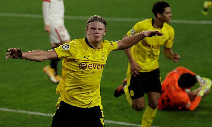 Haaland giúp Dortmund nắm lợi thế trong cặp đấu với Sevilla. Ảnh: EPA.