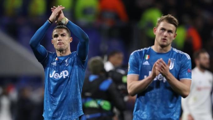 Ronaldo và De Ligt là hai ứng viên sáng giá nhất tiếp quản tấm băng đội trưởng Juventus từ hè này. Ảnh: AFP