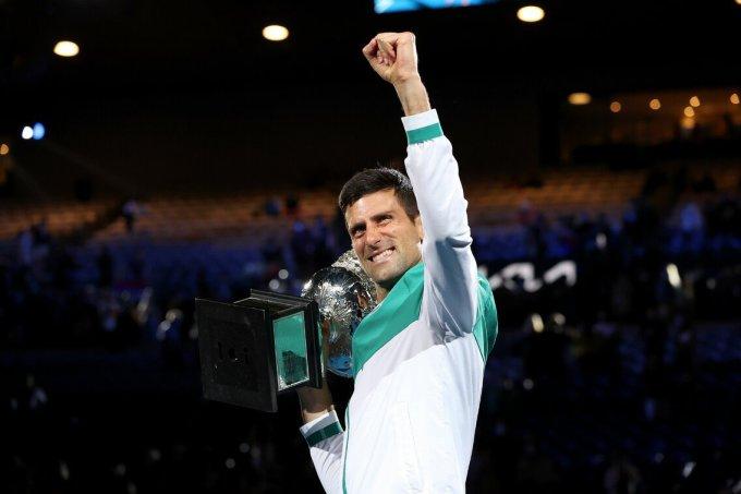 Djokovic cần chờ thêm bốn tháng để có cơ hội độc chiếm kỷ lục 21 Grand Slam ở Australia Mở rộng 2022 - nơi anh giữ kỷ lục toàn thắng chín trận chung kết. Ảnh: ATP